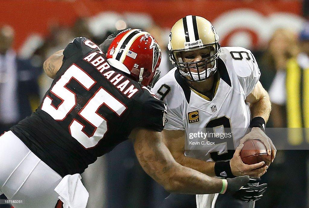 John Abraham #55 of the Atlanta Falcons sacks Drew Brees #9 of the New Orleans Saints at Georgia Dome on November 29, 2012 in Atlanta, Georgia.