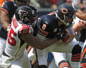 John Abraham of the Atlanta Falcons sacks Jay Cutler of the Chicago Bears at Soldier Field on September 11 2011 in Chicago Illinois The Bears...