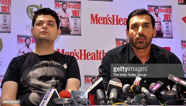 John Abraham with Dabboo Ratnani at the cover launch of Mens Health magazine featuring John Abraham in the latest issue