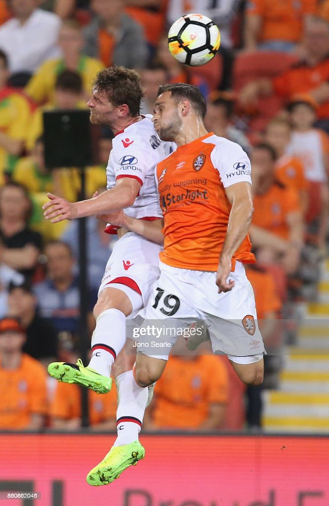 John Absalonsen of Adelaide and Jack Hingert compete for the ball during the round two A-League match between the Brisbane Roar and Adelaide United at Suncorp Stadium on October 13, 2017 in Brisbane, Australia.
