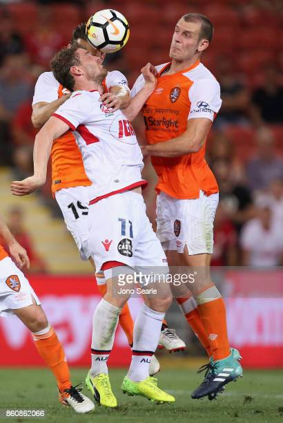 John Absalonsen of Adelaide and Luke De Vere compete for the ball during the round two ALeague match between the Brisbane Roar and Adelaide United at...
