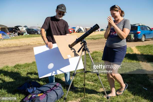 John Adlington and Tricia Dacie successfully setup a telescope to project an image of the Sun on a white matte board They are some of the total solar...