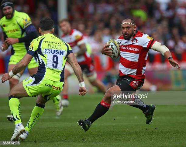 John Afoa of Gloucester Rugby takes on Mike Phillips of Sale Sharks during the Aviva Premiership match between Gloucester Rugby and Sale Sharks at...