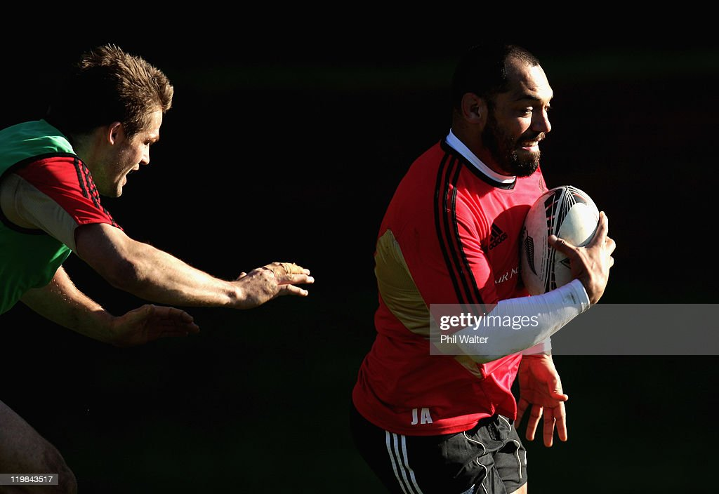 John Afoa of the All Blacks (R) runs past the tackle of Richie McCaw (L) during a New Zealand All Blacks training session at Rugby League Park on July 26, 2011 in Wellington, New Zealand.