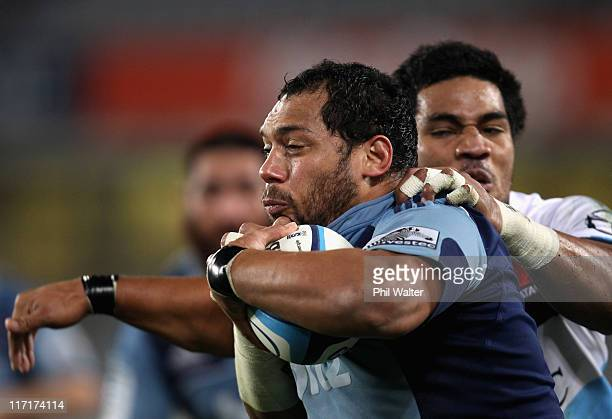 John Afoa of the Blues is tackled by Sitaleki Timani of the Waratahs during the Super Rugby qualifier match between the Blues and the Waratahs at...