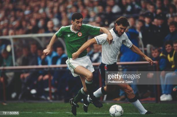 John Aldridge of the Republic of Ireland team attempts to tackle English defender Tony Adams for the ball during the UEFA European Championship...