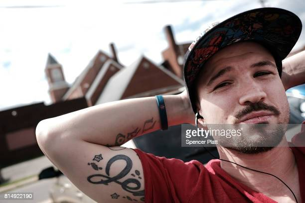 John Allen a recovered heroin addict attends a march through the streets of Norwalk against the epidemic of heroin in the community on July 14 2017...