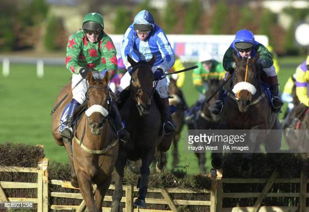 John Allen rides Dromlease Express over the last fence closely followed by Georges Girl and Macs Joy before winning the Pierse Hurdle at Leopardstown...