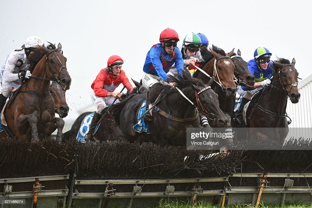 John Allen riding Ancient King jumps the second last hurdle in Race 3, the George Taylor Memorial Hurdle during Brierly Day at Warrnambool Race Club on May 3, 2016 in Warrnambool, Australia.
