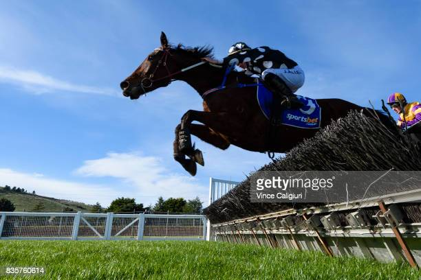 John Allen riding Chequered Flag before finishing runner up in Race 4 JJ Houlahan Hurdle during The Grand National Steeple Day on August 20 2017 in...