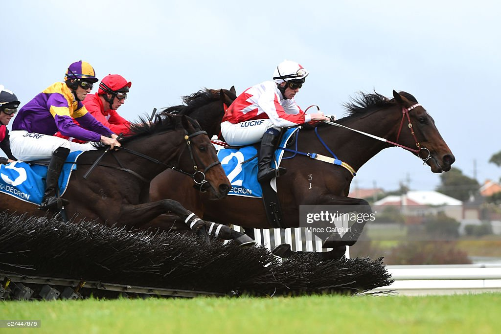 John Allen riding Fastnet Isle clears a jump before winning Race 1, the Carlton Mid Maiden Hurdle during Brierly Day at Warrnambool Race Club on May 3, 2016 in Warrnambool, Australia.