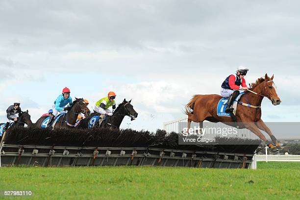 John Allen riding Gingerboy jumping the second last hurdle before winning Race 6 the Galleywood Hurdle during Brierly Day at Warrnambool Race Club on...