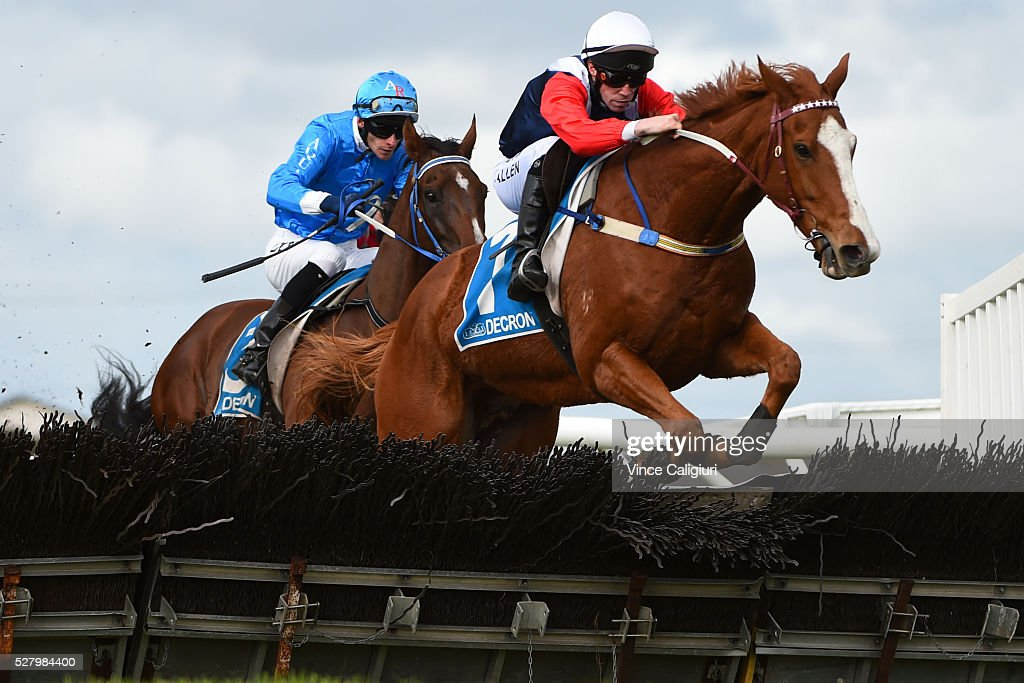 John Allen riding Gingerboy jumping the second last hurdle before winning Race 6, the Galleywood Hurdle during Brierly Day at Warrnambool Race Club on May 4, 2016 in Warrnambool, Australia.