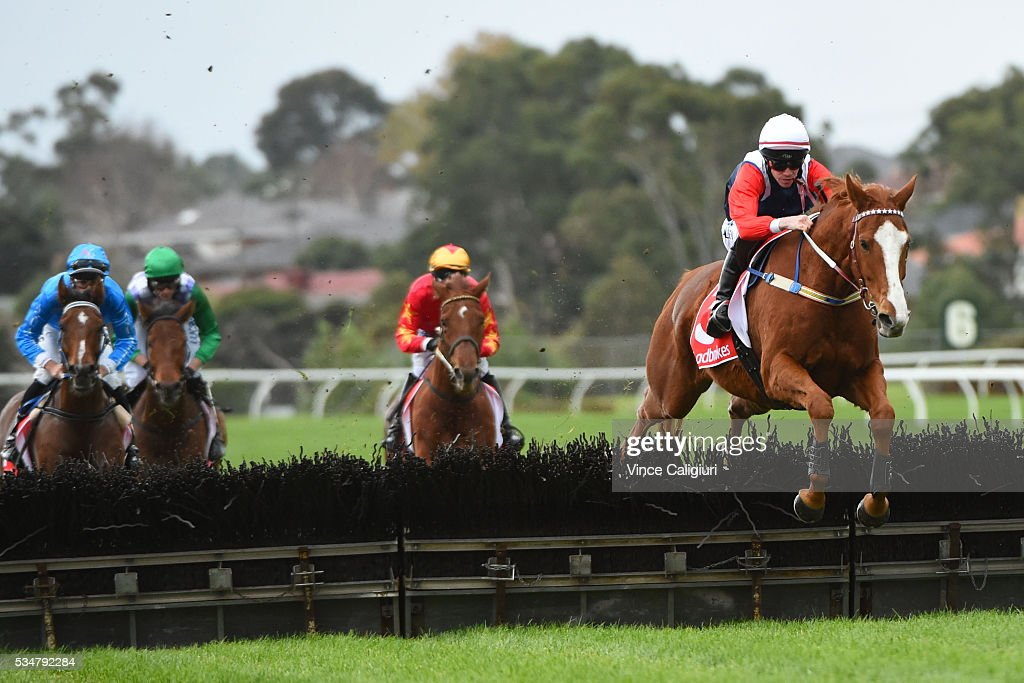<a gi-track='captionPersonalityLinkClicked' href=/galleries/search?phrase=John+Allen+-+Jockey&family=editorial&specificpeople=15787046 ng-click='$event.stopPropagation()'>John Allen</a> riding Gingerboy jumps the hurdle in the first lap before finishing runnerup in Race 1, The Australian Hurdle during Melbourne Racing at Sandown Lakeside on May 28, 2016 in Melbourne, Australia.