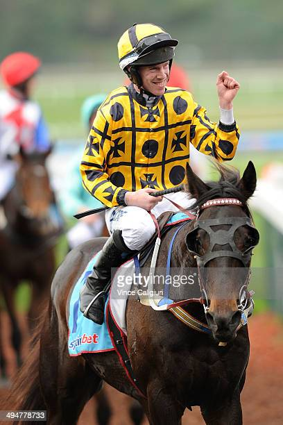 John Allen riding Gotta Take Care after winning Race 4 The Australian Hurdle during Melbourne Racing at Sandown Lakeside on May 31 2014 in Melbourne...