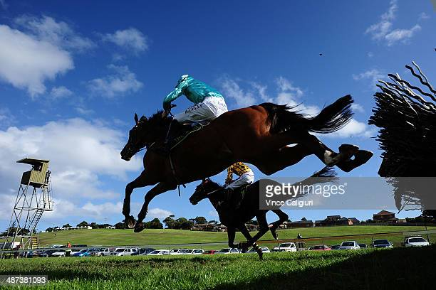 John Allen riding Gotta Take Care jumps the last hurdle before winning Race 5 the Sovereign Resort Galleywood Hurdle during the Warrnambool May...