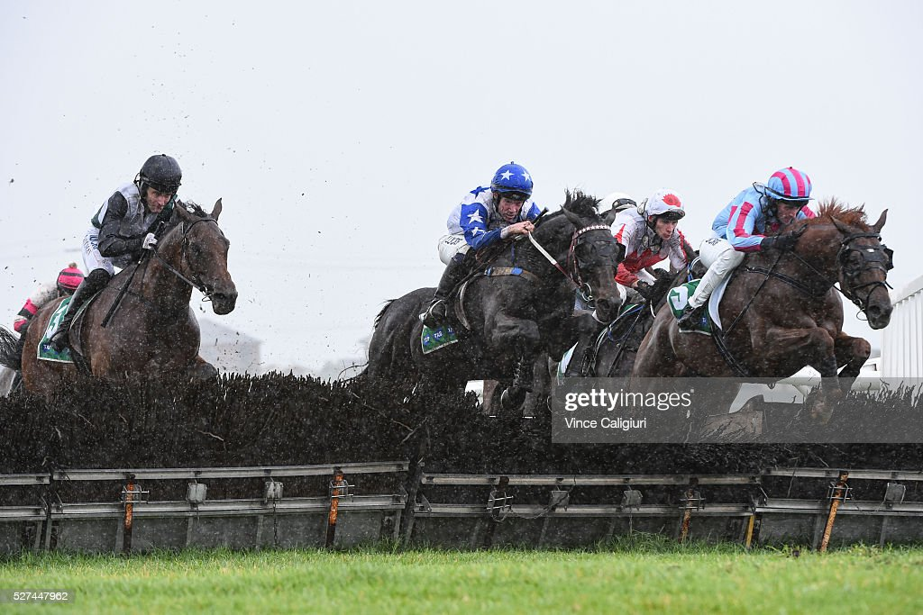 John Allen riding Paraggi jumping the secong last hurdle before winning Race 2, the TAB.Com.au Maiden Hurdle during Brierly Day at Warrnambool Race Club on May 3, 2016 in Warrnambool, Australia.