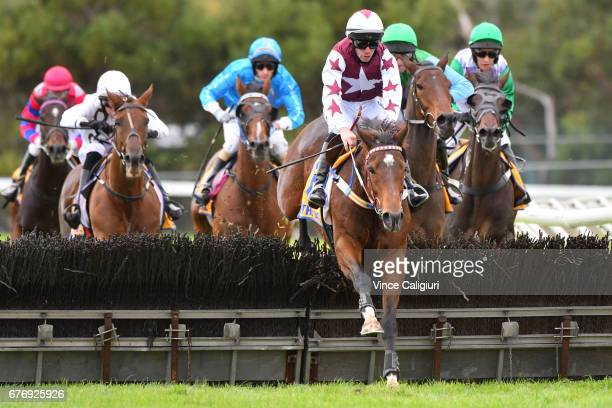 John Allen riding Renew jumps the last hurdle before winning Race 6 Galleywood Hurdle during the Warrnambool Racing Carnival on May 3 2017 in...