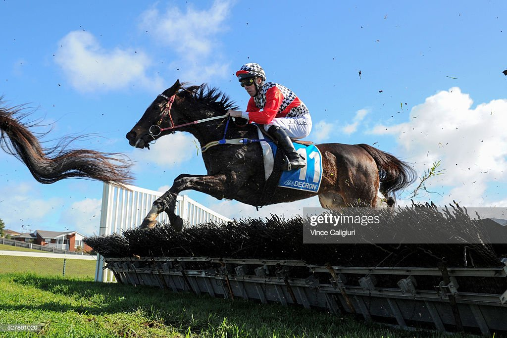 John Allen riding Waxing jumps a hurdle during first lap before winning Race 1,the Decron Maiden Hurdle during Brierly Day at Warrnambool Race Club on May 4, 2016 in Warrnambool, Australia.