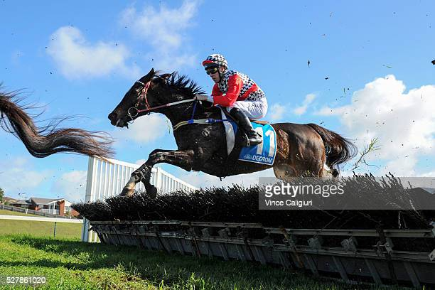John Allen riding Waxing jumps a hurdle during first lap before winning Race 1the Decron Maiden Hurdle during Brierly Day at Warrnambool Race Club on...