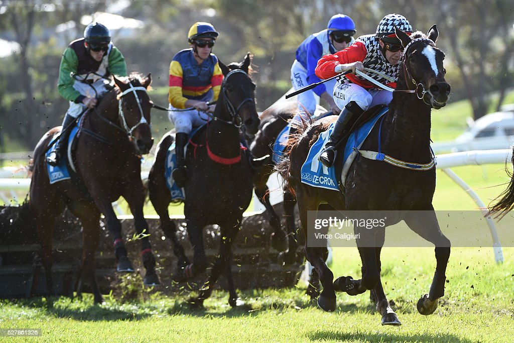 John Allen riding Waxing jumps the last hurdle before winning Race 1,the Decron Maiden Hurdle during Brierly Day at Warrnambool Race Club on May 4, 2016 in Warrnambool, Australia.