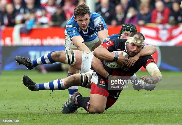 John Alofa of Gloucester Rugby is tackled by Nic Cudd of Newport Gwent Dragons during the European Rugby Challenge Cup match between Gloucester Rugby...