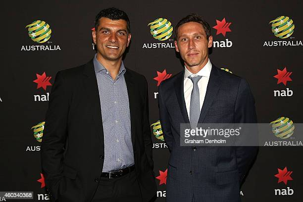 John Aloisi and Mark Milligan pose prior to the NAB FFA Boardroom Luncheon at Docklands on December 12 2014 in Melbourne Australia
