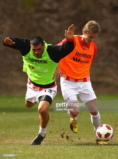 John Aloisi and Matt Thompson of the Heart contest for the ball during a Melbourne Heart training session at Scotch College on August 24 2010 in...