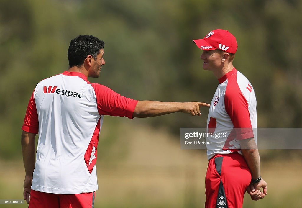 John Aloisi, coach of the Heart talks to Hayden Foxe, assistant coach of the Heart during a Melbourne Heart A-League training session at La Trobe University Sports Fields on February 21, 2013 in Melbourne, Australia.