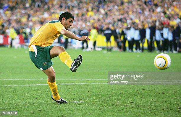 John Aloisi of Australia scores the winning goal in the penalty shootout during the second leg of the 2006 FIFA World Cup qualifying match between...