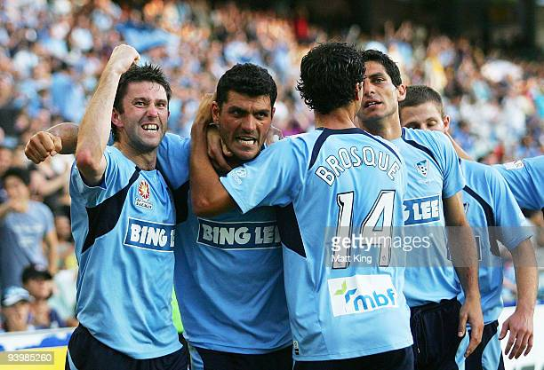 John Aloisi of Sydney celebrates scoring a first half goal with Terry McFlynn and Alex Brosque during the round 17 ALeague match between Sydney FC...