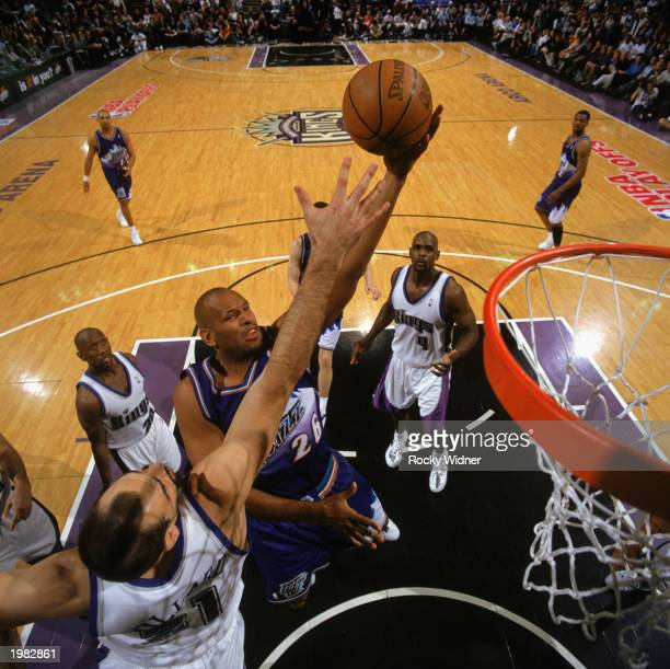 John Amaechi of the Utah Jazz contests the defense of Vlade Divac of the Sacramento Kings in Game 5 of the Western Conference Quarterfinals during...