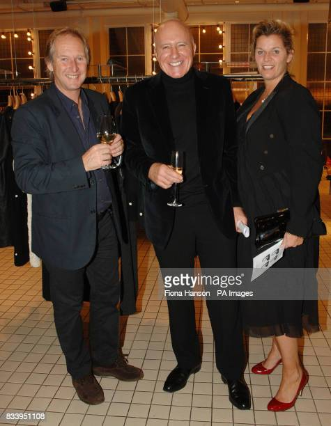 John and belle Robinson owners of Jigsaw and Bluebird with retail entrepreneur Colin Fenn at an exhibition of limited edition photographs of...