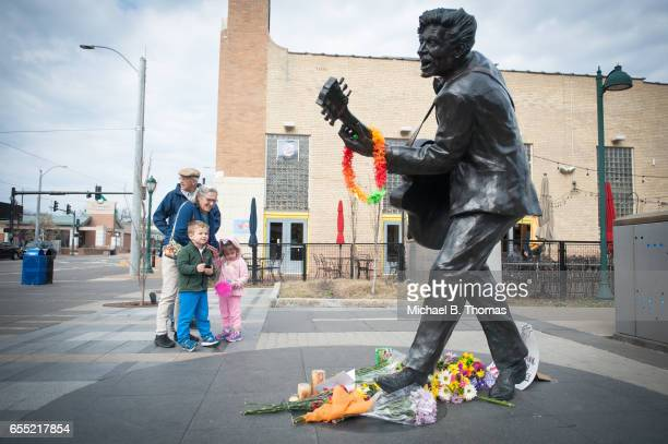 John and Carolyn Hellmuth of University City visit the statue of singer and musician Chuck Berry with their grandchildren Millie and Maxon in...