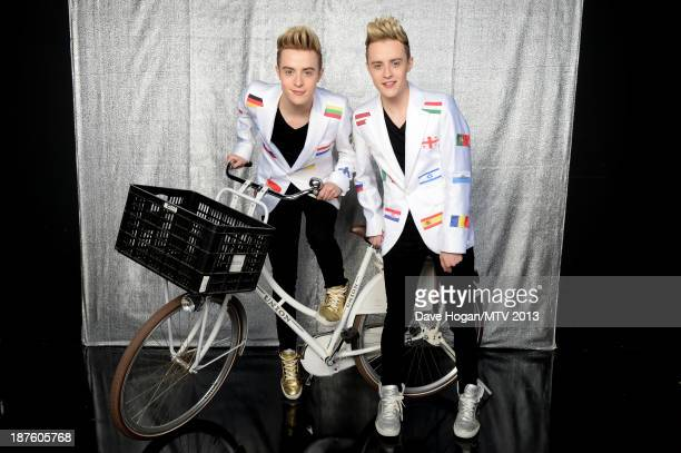 John and Edward Grimes of Jedward pose in the VIP Glamour Pit during the MTV EMA's 2013 at the Ziggo Dome on November 10 2013 in Amsterdam Netherlands
