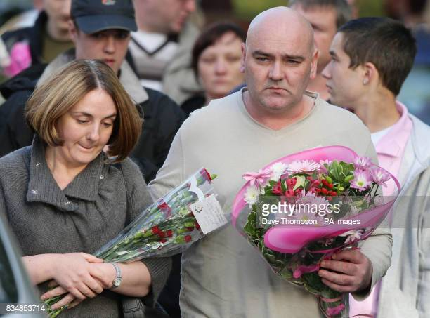 John and Toni Lappin lay flowers at the scene where their son Joseph Lappin was stabbed to death outside a youth club in Everton on Monday night