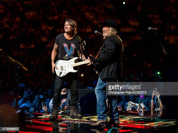 John Anderson and Keith Urban perform onstage at the ACM Presents Superstar Duets at Globe Life Park in Arlington on April 18 2015 in Arlington Texas