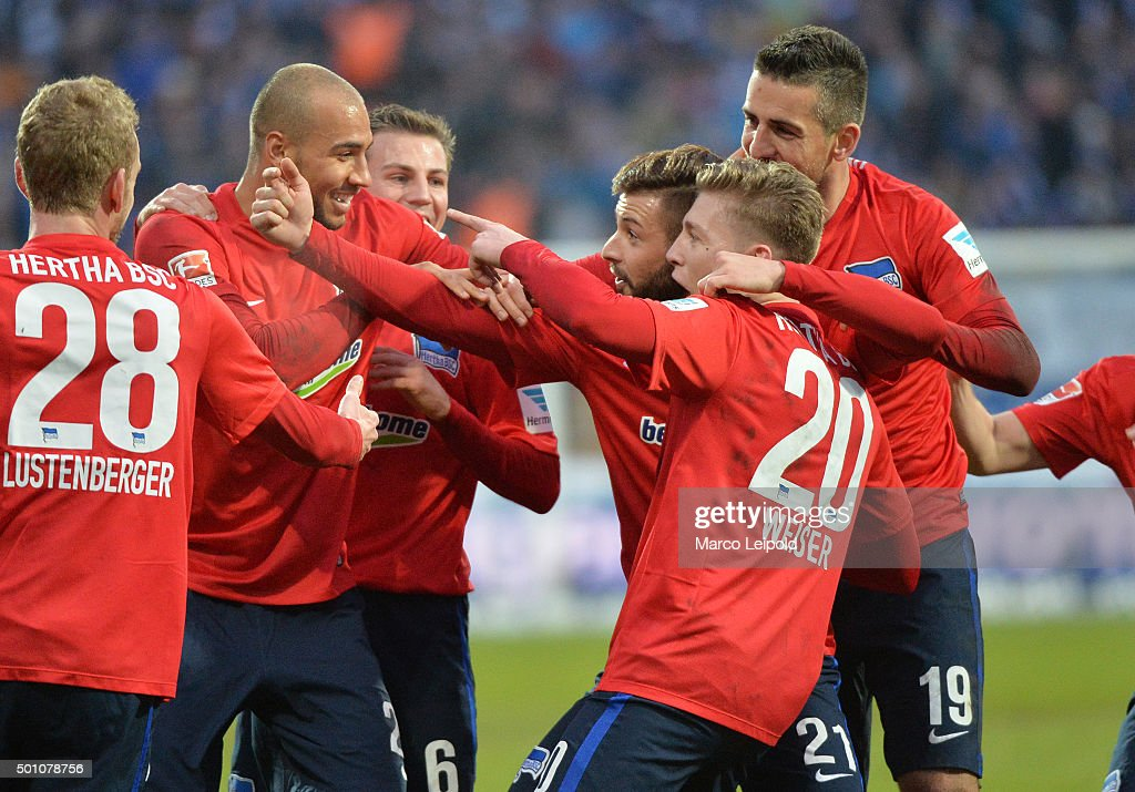 John Anthony Brooks, Marvin Plattenhardt, Mitchell Weiser and Vedad Ibisevic of Hertha BSC celebrate after scoring the 0:2 during the Bundesliga match between SV Darmstadt 98 and Hertha BSC on December 12, 2015 in Darmstadt, Germany.