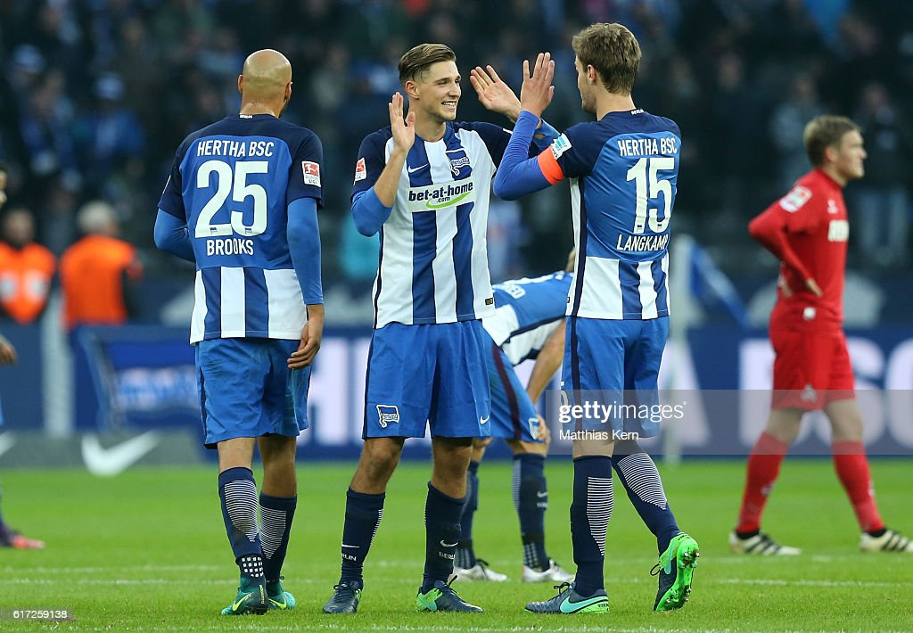 John Anthony Brooks, Niklas Stark and Sebastian Langkamp (L-R) of Berlin show their delight after winning the Bundesliga match between Hertha BSC and 1. FC Koeln at Olympiastadion on October 22, 2016 in Berlin, Germany.