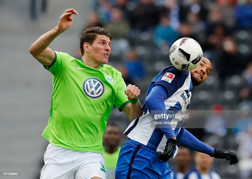 John Anthony Brooks of Hertha BSC and Mario Gomez of VfL Wolfsburg compete for the ball during the Bundesliga match between Hertha BSC and VfL Wolfsburg at Olympiastadion on April 22, 2017 in Berlin, Germany.