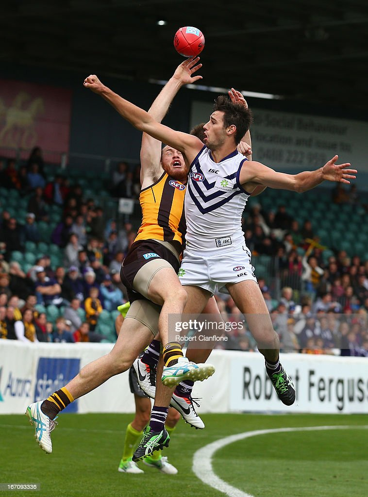 John Anthony of the Dockers spoils the ball for <a gi-track='captionPersonalityLinkClicked' href=/galleries/search?phrase=Jarryd+Roughead&family=editorial&specificpeople=227104 ng-click='$event.stopPropagation()'>Jarryd Roughead</a> of the Hawks during the round four AFL match between the Hawthorn Hawks and the Fremantle Dockers at Aurora Stadium on April 20, 2013 in Launceston, Australia.