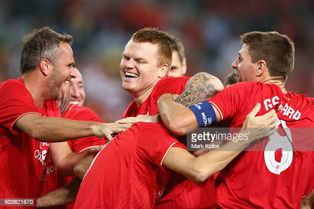 John Arne Riise and Steven Gerrard congratulate Ian Rush of the Liverpool FC Legends as he celebrates with is team mates after scoring a goal during...