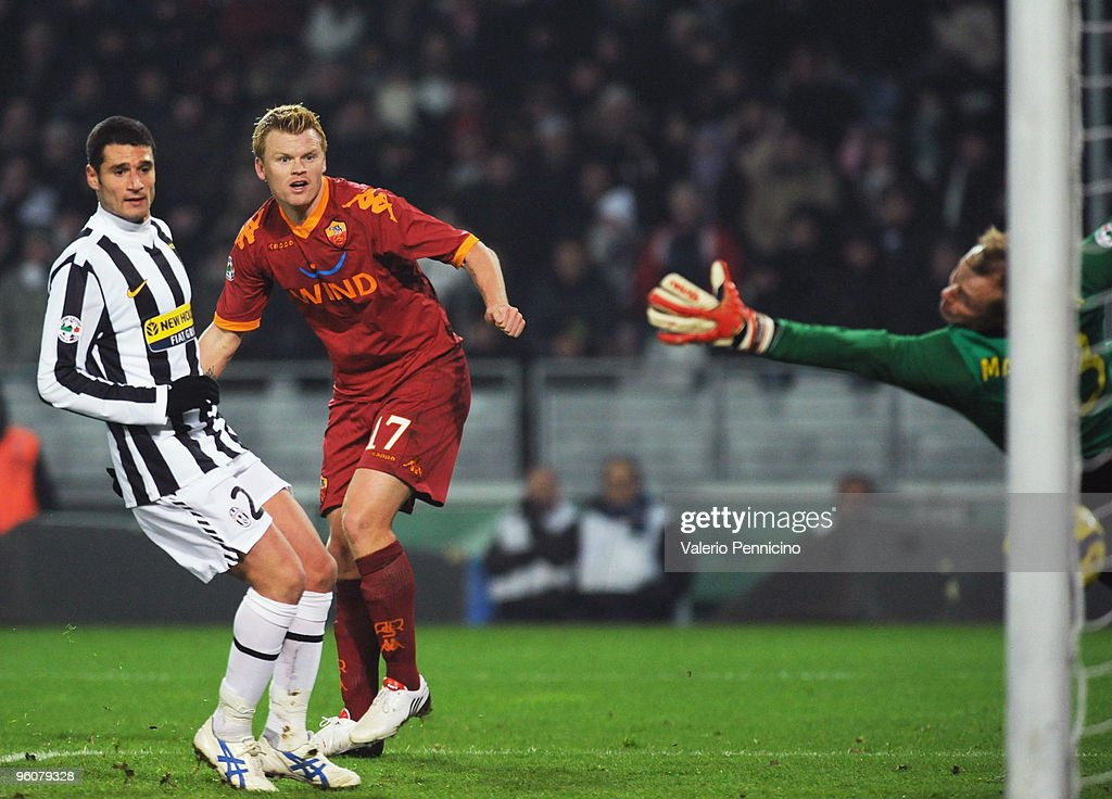 <a gi-track='captionPersonalityLinkClicked' href=/galleries/search?phrase=John+Arne+Riise&family=editorial&specificpeople=204354 ng-click='$event.stopPropagation()'>John Arne Riise</a> (C) of AS Roma scores his goal during the Serie A match between Juventus FC and AS Roma at Olimpico Stadium on January 23, 2010 in Turin, Italy.