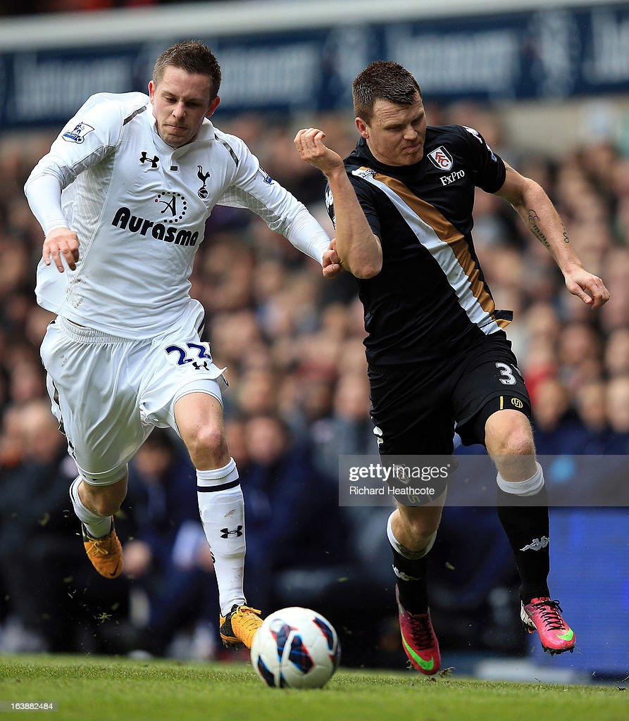 <a gi-track='captionPersonalityLinkClicked' href=/galleries/search?phrase=John+Arne+Riise&family=editorial&specificpeople=204354 ng-click='$event.stopPropagation()'>John Arne Riise</a> of Fulham holds off <a gi-track='captionPersonalityLinkClicked' href=/galleries/search?phrase=Gylfi+Sigurdsson&family=editorial&specificpeople=6401581 ng-click='$event.stopPropagation()'>Gylfi Sigurdsson</a> of Tottenham during the Barclay's Premier League match between Tottenham Hotspur and Fulham at White Hart Lane on March 17, 2013 in London, England.
