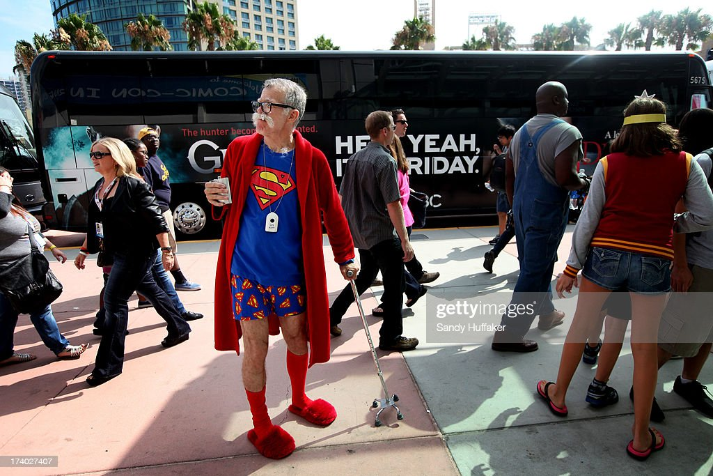 John Ash wears a Superman themed outfit at Comic Con on July 19, 2013 in San Diego, California. Comic Con International Convention is the world's largest comic and entertainment event and hosts celebrity movie panels, a trade floor with comic book, science fiction and action film-related booths, as well as artist workshops and movie premieres.