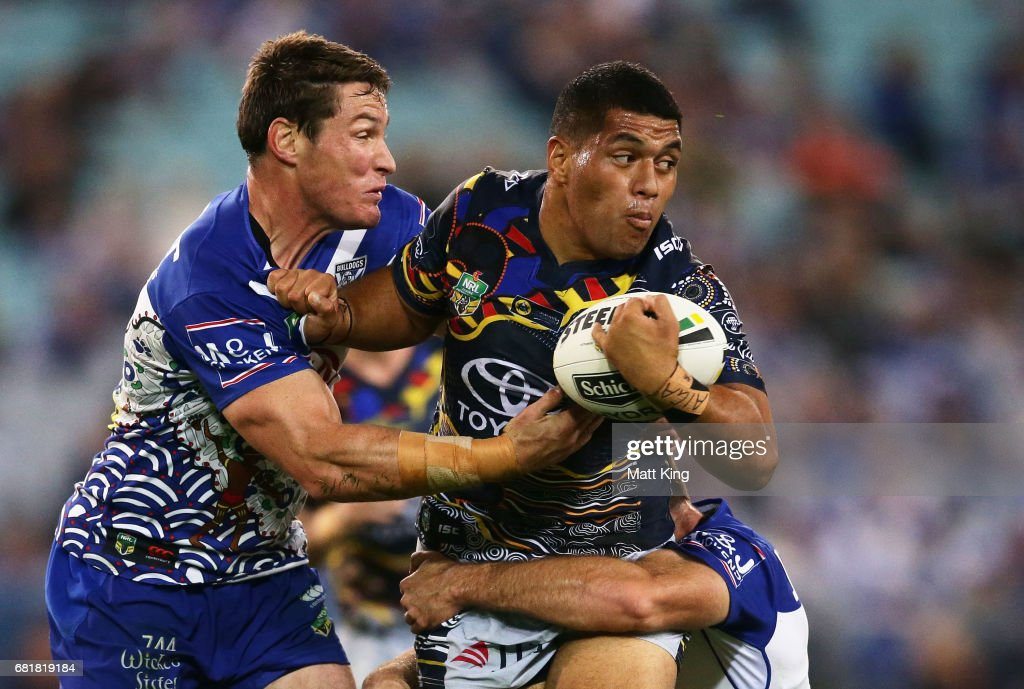 John Asiata of the Cowboys is tackled by Josh Jackson of the Bulldogs during the round 10 NRL match between the Canterbury Bulldogs and the North Queensland Cowboys at ANZ Stadium on May 11, 2017 in Sydney, Australia.