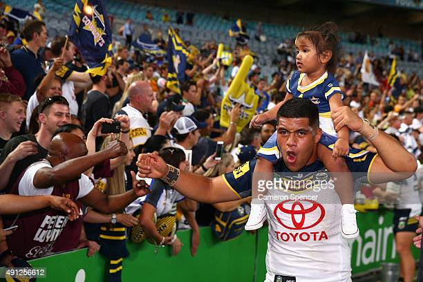 John Asiata of the Cowboys thanks fans after winning the 2015 NRL Grand Final match between the Brisbane Broncos and the North Queensland Cowboys at...