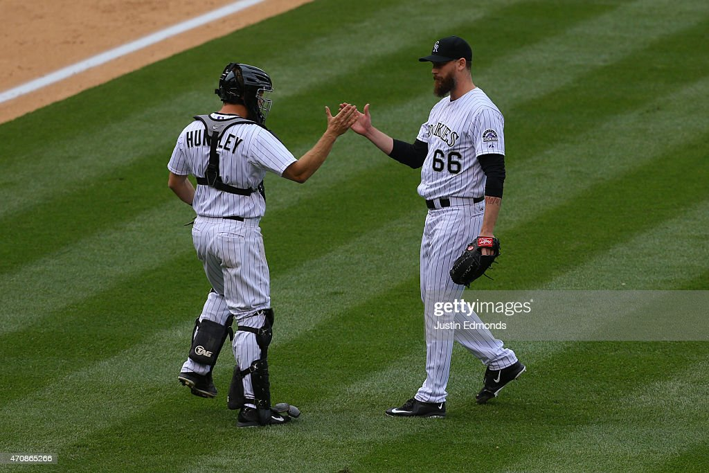 John Axford #66 and Nick Hundley #4 of the Colorado Rockies celebrate after a win against the San Diego Padres at Coors Field on April 23, 2015 in Denver, Colorado. The Rockies defeated the Padres 2-1.