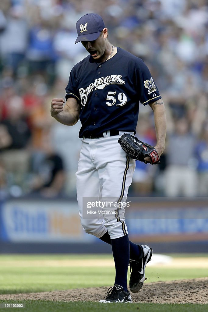 <a gi-track='captionPersonalityLinkClicked' href=/galleries/search?phrase=John+Axford&family=editorial&specificpeople=6825257 ng-click='$event.stopPropagation()'>John Axford</a> #59 of the Milwaukee Brewers celebrates after the 12-8 win over the Pittsburgh Pirates at Miller Park on September 02, 2012 in Milwaukee, Wisconsin.
