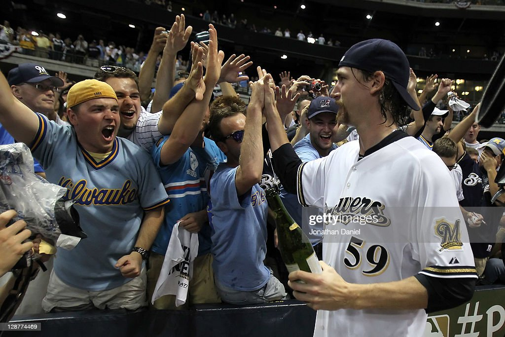 John Axford #59 of the Milwaukee Brewers celebrates with fans after the Brewers 3-2 10 inning victory against the Arizona Diamondbacks in Game Five of the National League Division Series at Miller Park on October 7, 2011 in Milwaukee, Wisconsin.